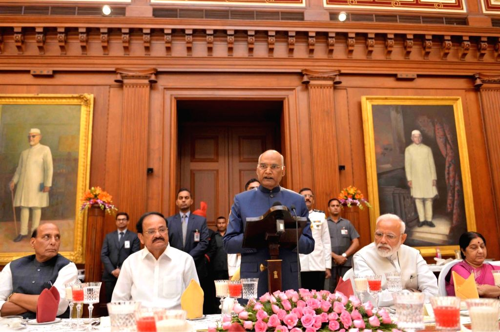 President Ram Nath Kovind addresses during a banquet hosted by him for the outgoing Union Council of Ministers led by Prime Minister Narendra Modi at the Rashtrapati Bhavan, in New Delhi ... - Narendra Modi, Ministers Rajnath Singh, Sushma Swaraj, M. Venkaiah Naidu and Nath Kovind