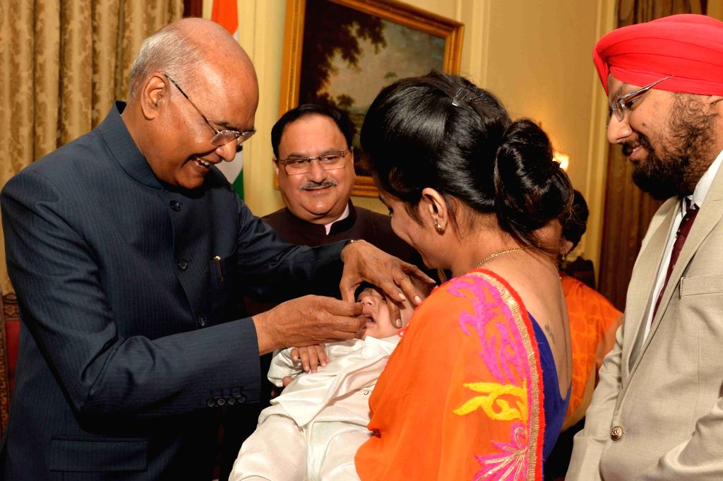 President Ram Nath Kovind administers polio drops to a child at Rashtrapati Bhavan in New Delhi, on March 9, 2019. - Nath Kovind