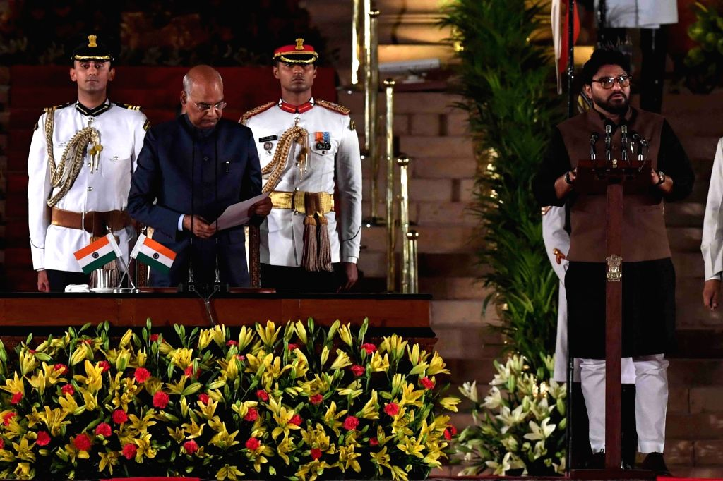 President Ram Nath Kovind administers the oath of office to Asansol BJP MP Babul Supriyo as Union Minister at a swearing-in ceremony at Rashtrapati Bhavan, in New Delhi on May 30, 2019. - Nath Kovind
