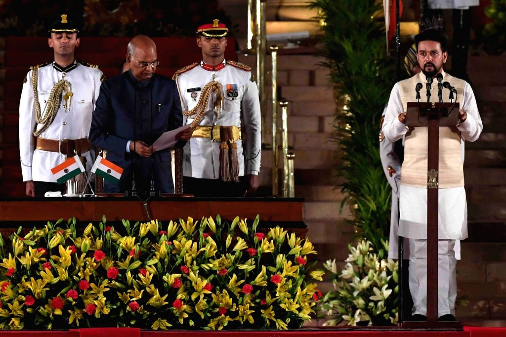 President Ram Nath Kovind administers the oath of office to Hamirpur BJP MP Anurag Thakur as Union Minister at a swearing-in ceremony at Rashtrapati Bhavan, in New Delhi on May 30, 2019. - Nath Kovind