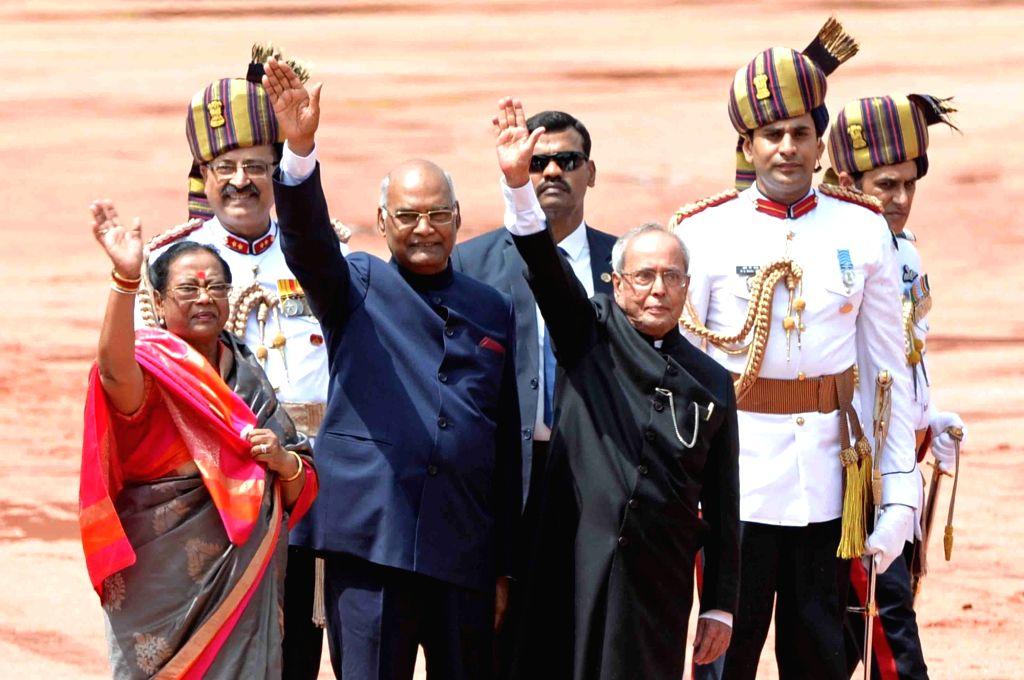 President Ram Nath Kovind along with his spouse Savita Kovind and former President Pranab Mukherjee at the Rashtrapati Bhavan in New Delhi, on July 25, 2017. - Nath Kovind and Pranab Mukherjee