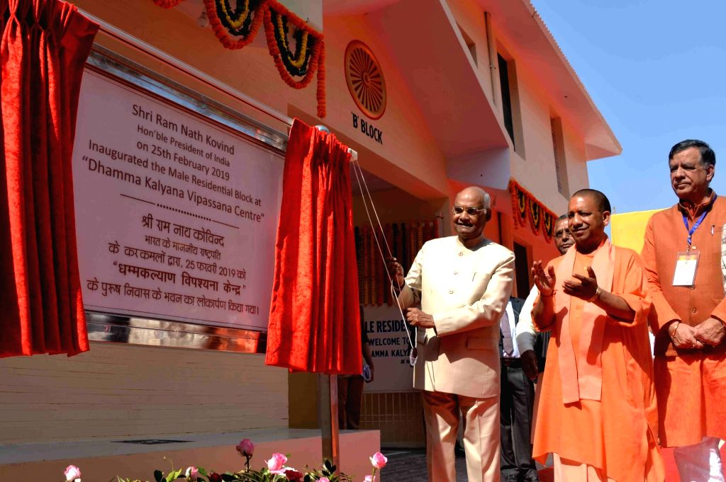 President Ram Nath Kovind along with Uttar Pradesh Chief Minister Yogi Adityanath unveils the plaque to inaugurate the new block of Dhamma Kalyana Kanpur International Vipassana Meditation ... - Yogi Adityanath and Nath Kovind