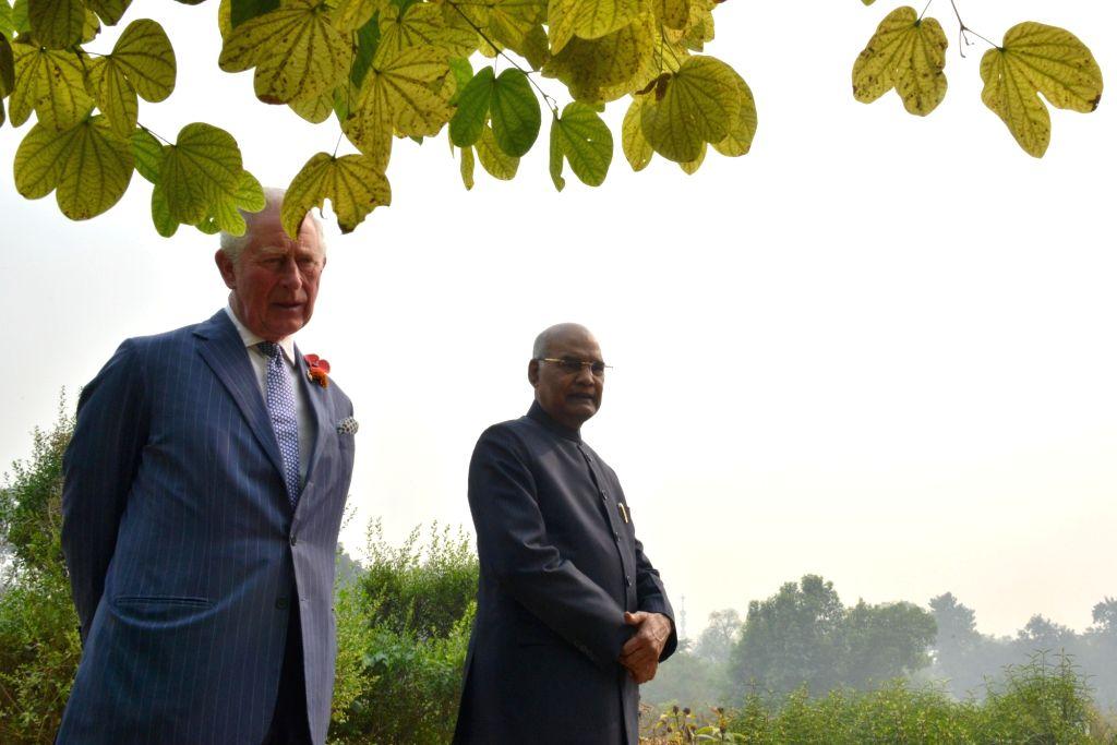 President Ram Nath Kovind and Britain's Prince Charles during the plantation of tree at Herbal Garden - 2 (Opp. North Steps) at Rashtrapati Bhavan in New Delhi on Nov 13, 2019. - Nath Kovind