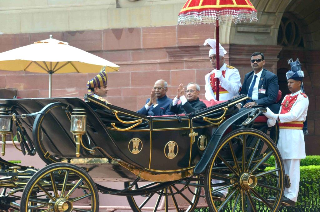 President Ram Nath Kovind and former President Pranab Mukherjee leave after the Guard of Honour in New Delhi, on July 25, 2017. - Nath Kovind and Pranab Mukherjee