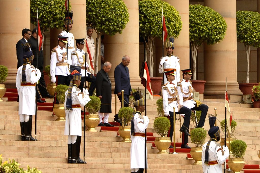 President Ram Nath Kovind and his predecessor Pranab Mukherje after the guard of honour ceremony in the forecourt of the Rashtrapati​ ​Bhavan in New Delhi on July 25, 2017. - Nath Kovind