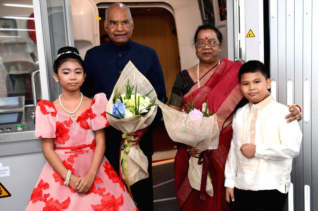 President Ram Nath Kovind and his wife Savita Kovind being presented with bouquets by children on their arrival at Aquino Ninoy International Airport in Manila, Philippines on Oct 17, 2019. - Nath Kovind