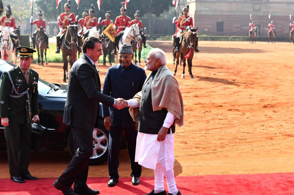 President Ram Nath Kovind and Prime Minister Narendra Modi receive Brazilian President Jair Bolsonaro at a Ceremonial Reception accorded to him at Rashtrapati Bhavan in New Delhi on Jan ... - Narendra Modi and Nath Kovind