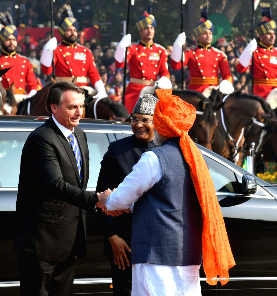 President Ram Nath Kovind and the Chief Guest Brazilian President Jair Messias Bolsonaro being received by Prime Minister Narendra Modi at the 71st Republic Day celebrations at Rajpath, in ... - Narendra Modi and Nath Kovind
