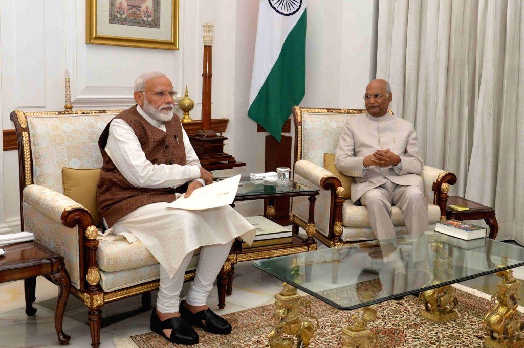 President Ram Nath Kovind appoints Narendra Modi to the office of Prime Minister of India at Rashtrapati Bhavan in New Delhi, on May 25, 2019.  A day after Prime Minister Narendra Modi ... - Narendra Modi and Nath Kovind
