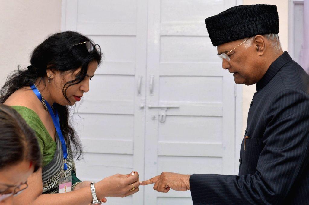 President Ram Nath Kovind being administered inedible ink after casting his vote for Delhi Assembly elections 2020, at Dr. Rajendra Prasad Kendriya Vidyalaya, Rashtrapati Bhavan complex, ... - Nath Kovind