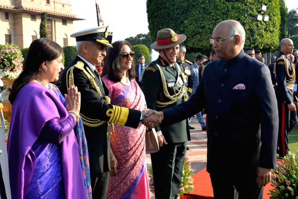 President Ram Nath Kovind being greeted by Navy Chief Admiral Sunil Lanba during 'At Home' reception organised at Rashtrapati Bhavan in New Delhi, on Jan 26, 2019. - Nath Kovind