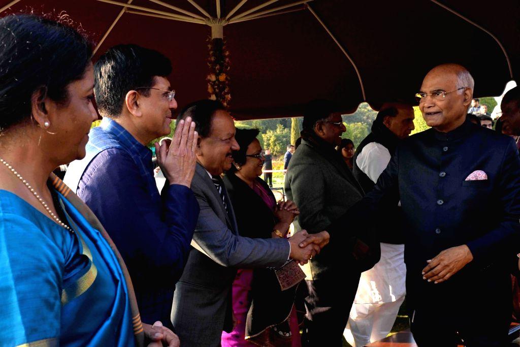 President Ram Nath Kovind being greeted by Union Ministers Nirmala Sitharaman, Piyush Goyal and Harsh Vardhan during 'At Home' reception organised at Rashtrapati Bhavan in New Delhi, ... - Nirmala Sitharaman, Piyush Goyal, Harsh Vardhan and Nath Kovind