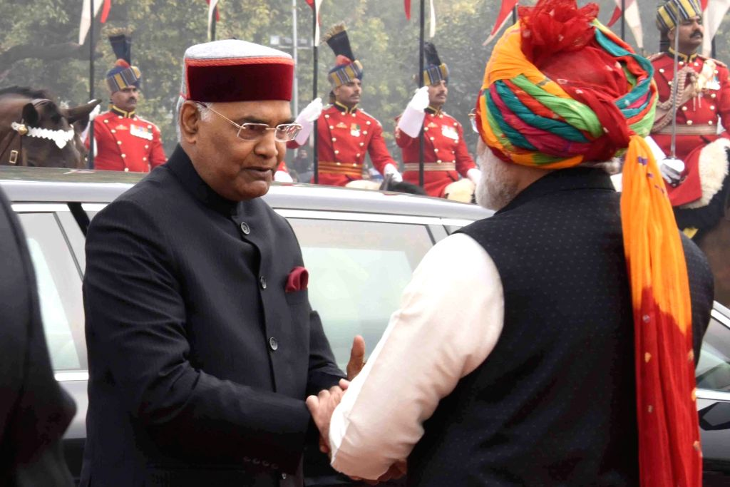 President Ram Nath Kovind being received by Prime Minister Narendra Modi on his arrival at the venue of Republic Day 2018 celebrations on Rajpath in New Delhi, on Jan 26, 2018. - Narendra Modi and Nath Kovind