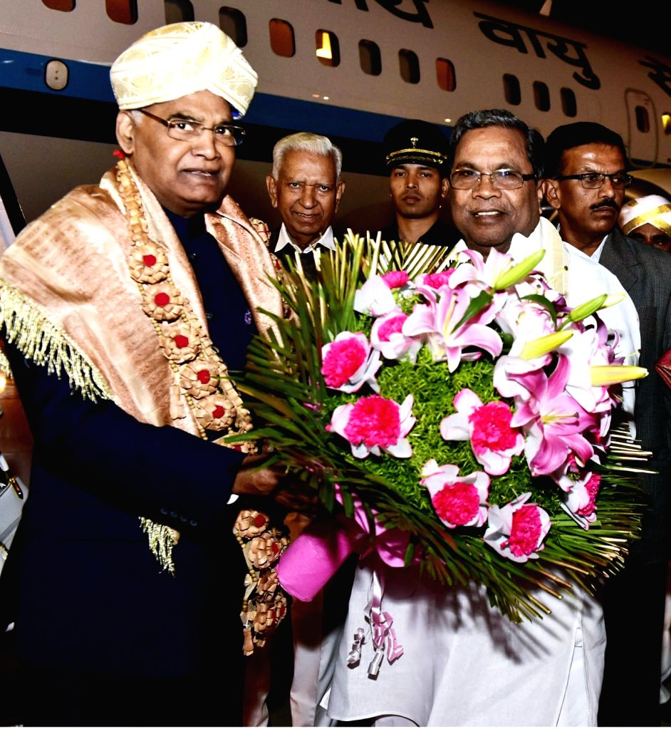 President Ram Nath Kovind being welcomed by Karnataka Chief Minister Siddaramaiah at HAL Airport in Bengaluru on Feb 6, 2018. - Siddaramaiah and Nath Kovind