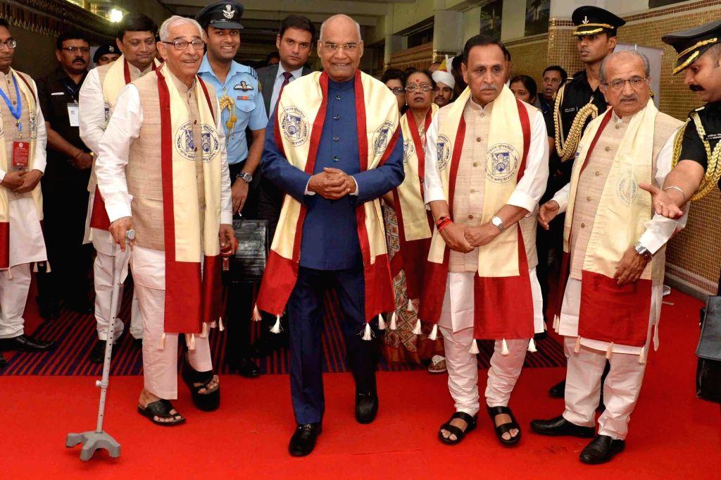 President Ram Nath Kovind (C), Gujarat Governor Om Prakash Kohli (L) and the state's Chief Minister Vijay Rupani (R) at the 66th Convocation of Gujarat University in Ahmedabad on Jan 21, ... - Vijay Rupani, Nath Kovind and Prakash Kohli