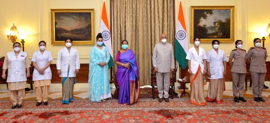 President Ram Nath Kovind celebrating Raksha Bandhan with the members of the nursing community, at Rashtrapati Bhavan, in New Delhi on Aug 3, 2020. - Nath Kovind