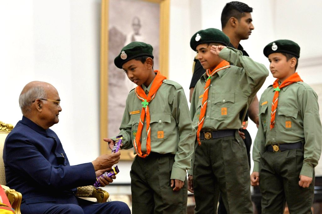 President Ram Nath Kovind distributes chocolates among students who came to meet him on the occasion of the birth anniversary of the the country's first Prime Minister Pandit Jawaharlal ... - Pandit Jawaharlal Nehru and Nath Kovind