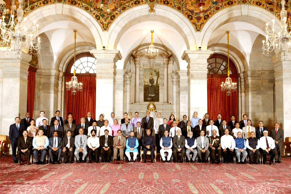 President Ram Nath Kovind during pose for a group photo with Directors of NITs, IIEST, SPAs, IIIT and IITs(PPP),in New Delhi, on July 19, 2018. Also seen Union Human Resource Development ... - Prakash Javadekar and Nath Kovind