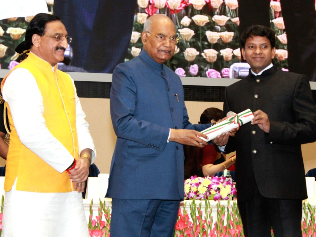 President Ram Nath Kovind felicitates A. Jebin Joel, Atomic Energy Central School Four, Anushaktinagar, Mumbai (Suburban), Maharashtra with 2019 National Award to Teachers on the occasion ... - Nath Kovind