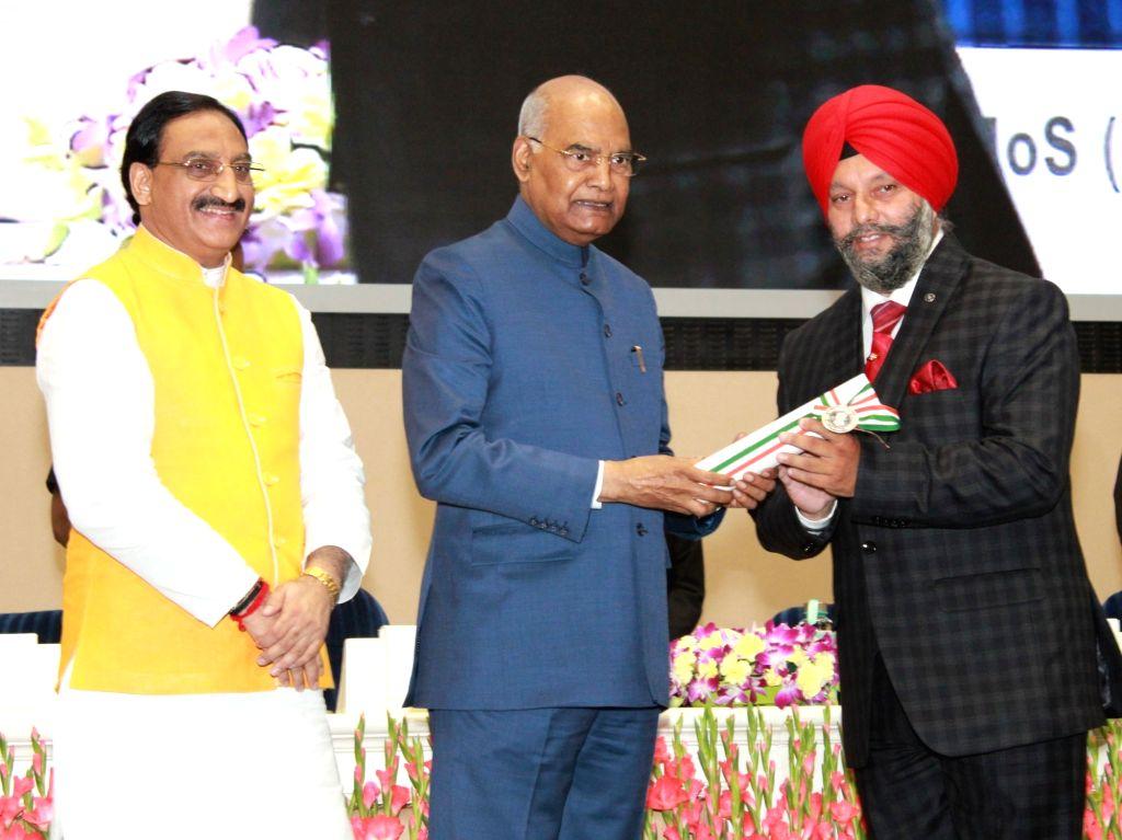 President Ram Nath Kovind felicitates Gurnam Singh, Government Upper Primary School Lahari, Barnoti, Kathua, Jammu & Kashmir with 2019 National Award to Teachers on the occasion of ... - Nath Kovind and Gurnam Singh