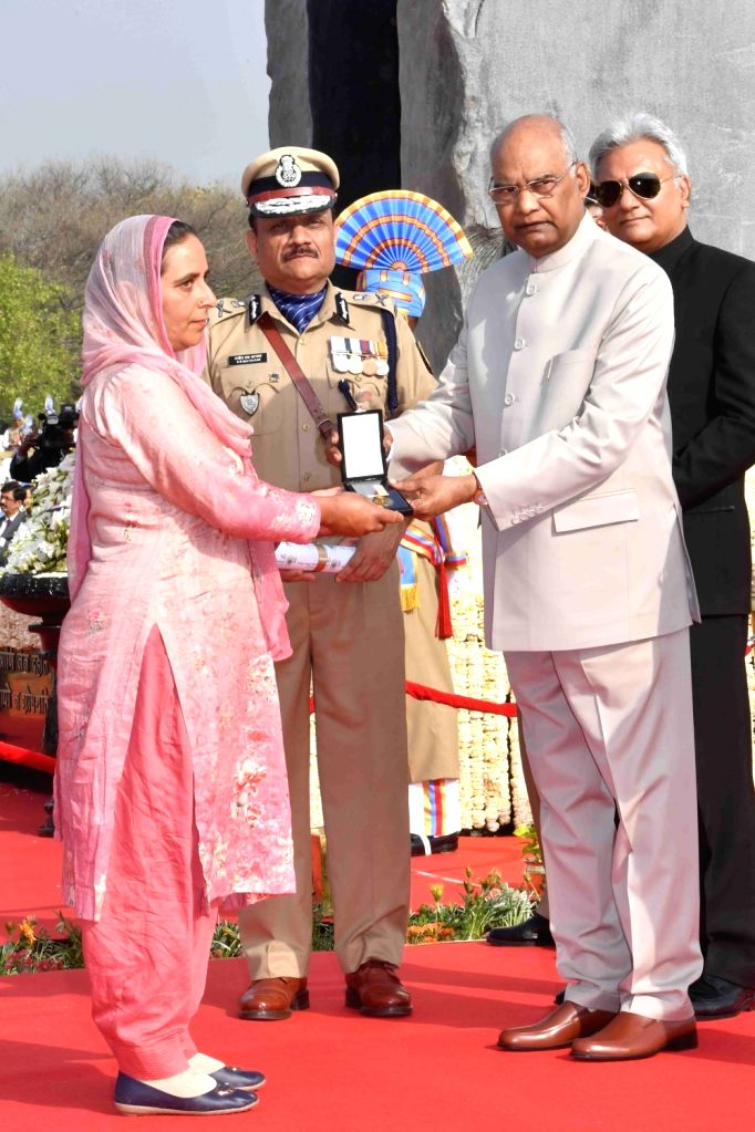 President Ram Nath Kovind felicitates the kin of the martyred security personnel during a remembrance service that marks the annual 'Valour Day' of Central Reserve Police Force (CRPF) at ... - Nath Kovind