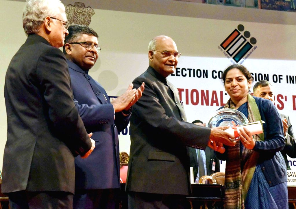 President Ram Nath Kovind gives away National Awards for the Best Electoral Practices at the 8th National Voters' Day programme in New Delhi on Jan 25, 2018. - Nath Kovind
