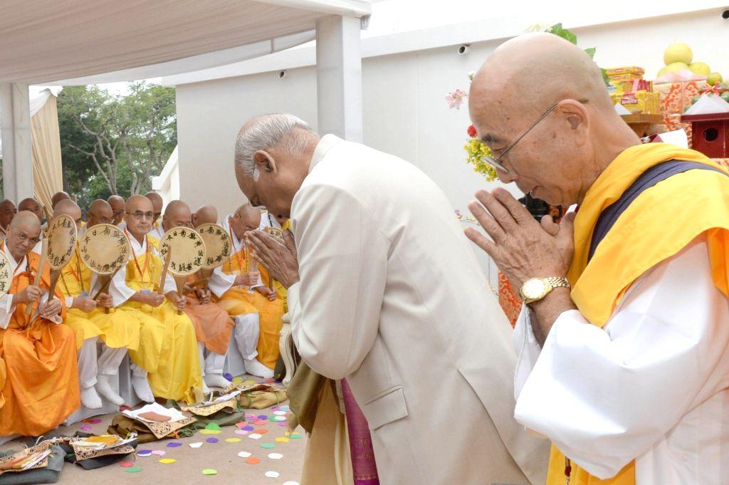 President Ram Nath Kovind greets Buddhist monks as he arrives at the 50th Anniversary celebrations of of Vishwa Shanti Stupa in Bihar's Rajgir on Oct 25, 2019. - Nath Kovind