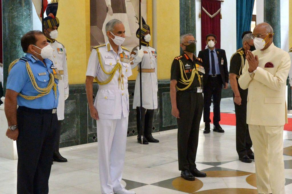 President Ram Nath Kovind greets Chief of Defence Staff (CDS) & Secretary Department of Military Affairs General Bipin Rawat, Chief of the Army Staff General Manoj Mukund Naravane, ... - Nath Kovind
