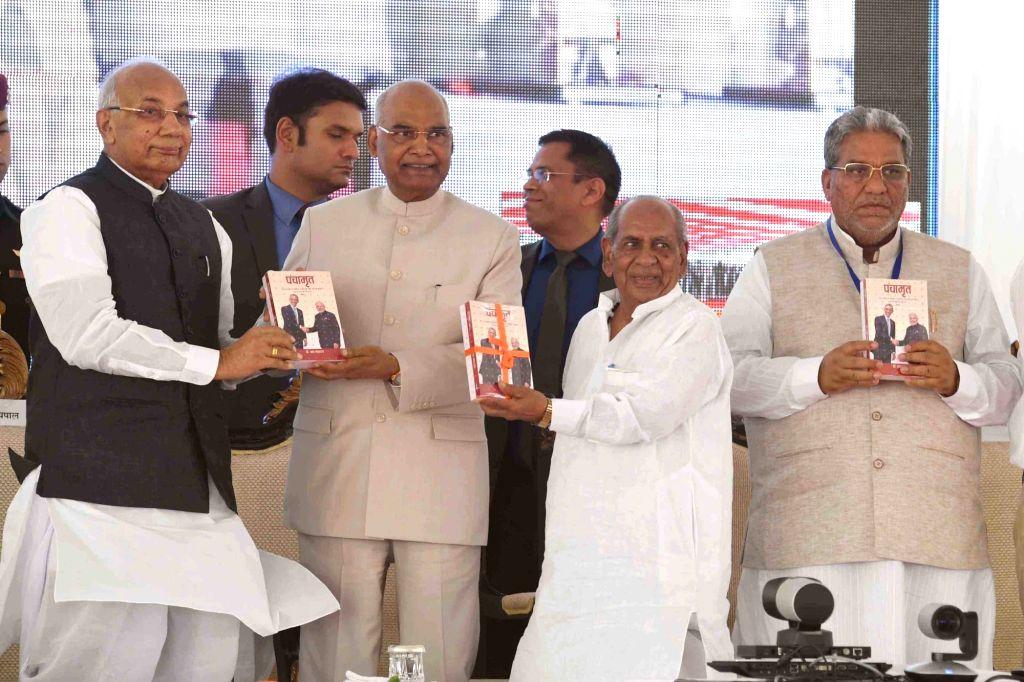 President Ram Nath Kovind, Haryana Governor Kaptan Singh Solanki and other dignitaries during Shiromani Kabir Prakat Diwas (the birth anniversary of saint Kabir Das) organised by Dhanak ... - Nath Kovind and Kaptan Singh Solanki