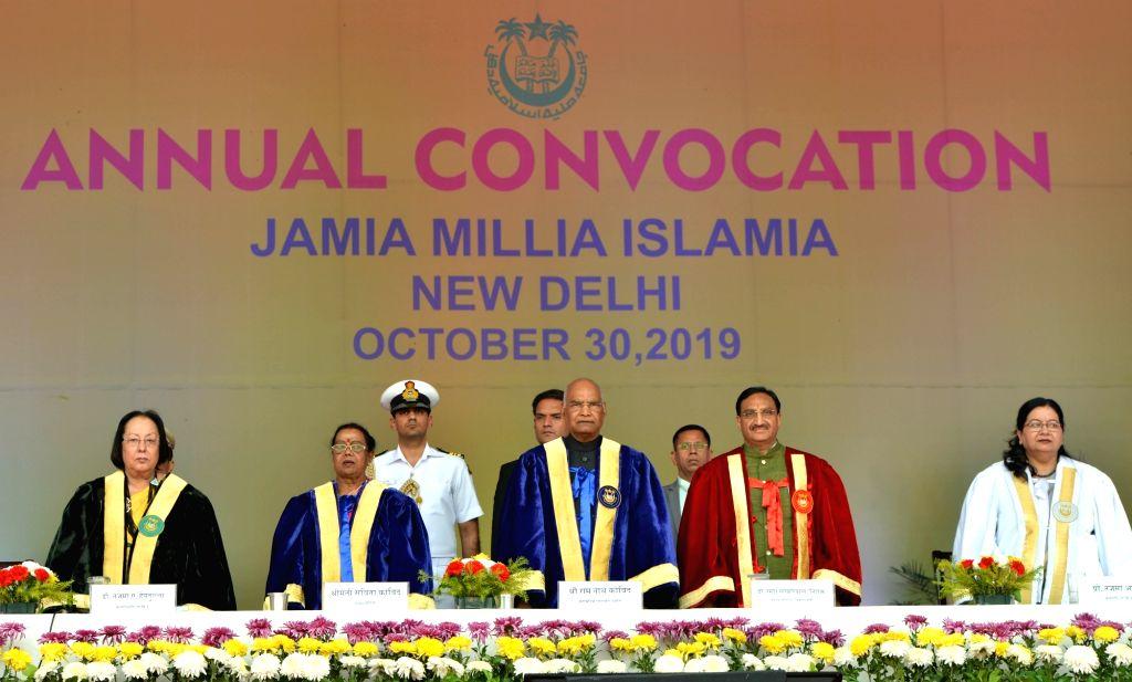 President Ram Nath Kovind, his wife Savita Kovind, Union HRD Minister Ramesh Pokhriyal Nishank, Manipur Governor and Jamia Millia Islamia (JMI) Chancellor Najma Heptulla and JMI ... - Ramesh Pokhriyal Nishank, Najma Heptulla and Nath Kovind