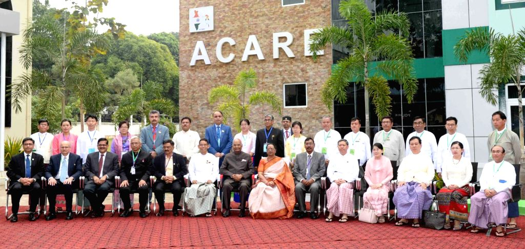President Ram Nath Kovind in a group photograph at the Advanced Centre for Agricultural Research and Education (ACARE), Yezin Agricultural University, in Naypyidaw, Myanmar, on Dec 12, ... - Nath Kovind