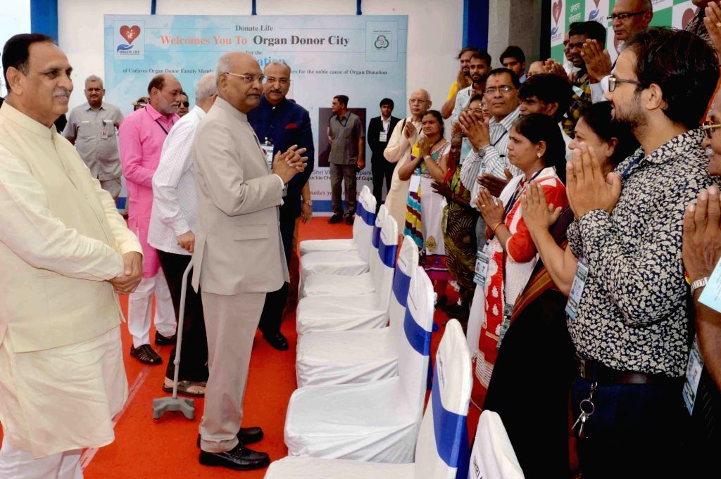 President Ram Nath Kovind interacts with the family members of cadaver organ donors during a felicitation programme, in Surat on May 29, 2018. - Nath Kovind
