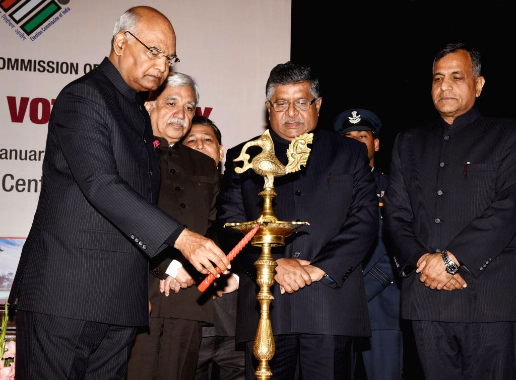 President Ram Nath Kovind lights the lamp at the 9th National level function of the National Voters' Day (NVD), in New Delhi on January 25, 2019. Also seen Union Minister Law and Justice ... - Law and Nath Kovind