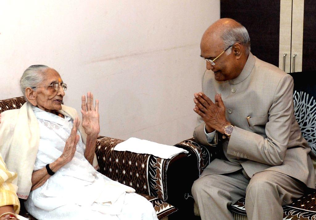 President Ram Nath Kovind meets Hira Baa, mother of the Prime Minister Narendra Modi in Gandhinagar, on Oct 13, 2019. - Narendra Modi and Nath Kovind