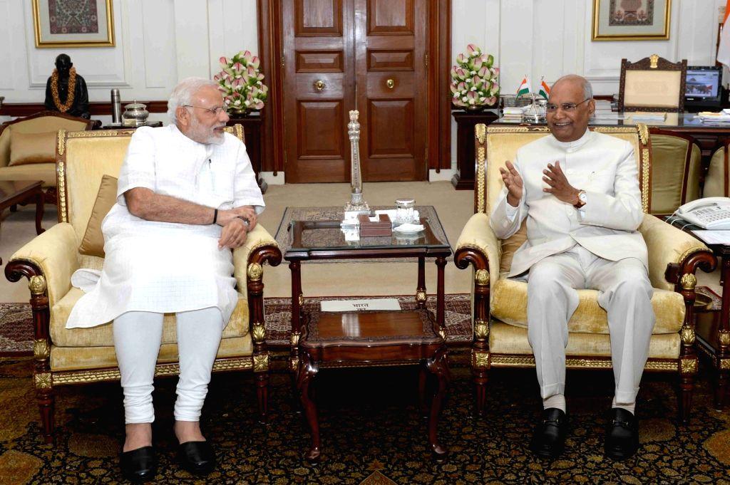 President Ram Nath Kovind meets Prime Minister Narendra Modi at Rashtrapati Bhavan, in New Delhi on June 11, 2018. - Narendra Modi and Nath Kovind