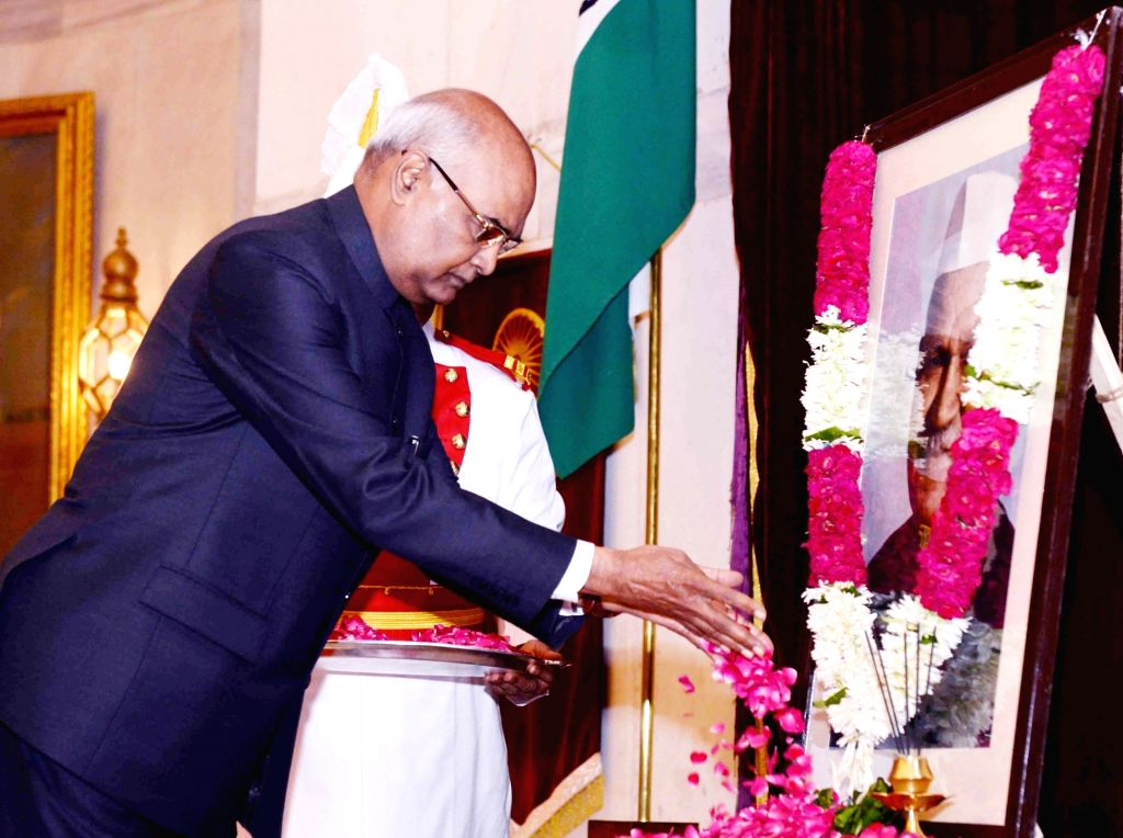 President Ram Nath Kovind pays floral tribute at the portrait of former President Shanker Dayal Sharma on his birth anniversary at Rashtrapati Bhavan in New Delhi on Aug 19, 2017. - Nath Kovind and Shanker Dayal Sharma