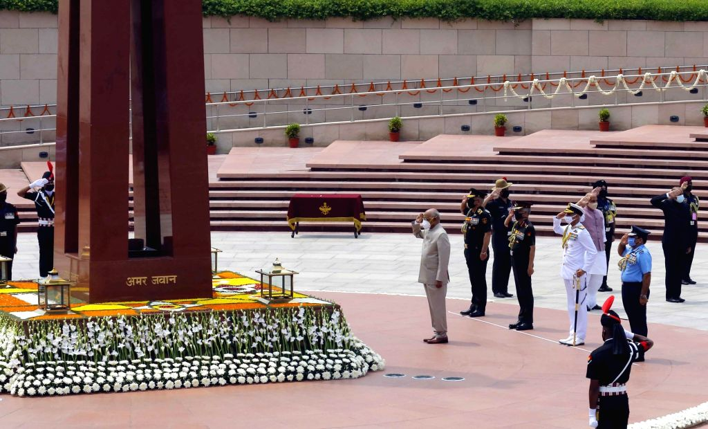 President Ram Nath Kovind pays homage at the National War Memorial on the occasion of 74th Independence Day, in New Delhi on Aug 15, 2020. Also seen Defence Minister Rajnath Singh, Chief ... - Rajnath Singh, Nath Kovind and Secretary Ajay Kumar