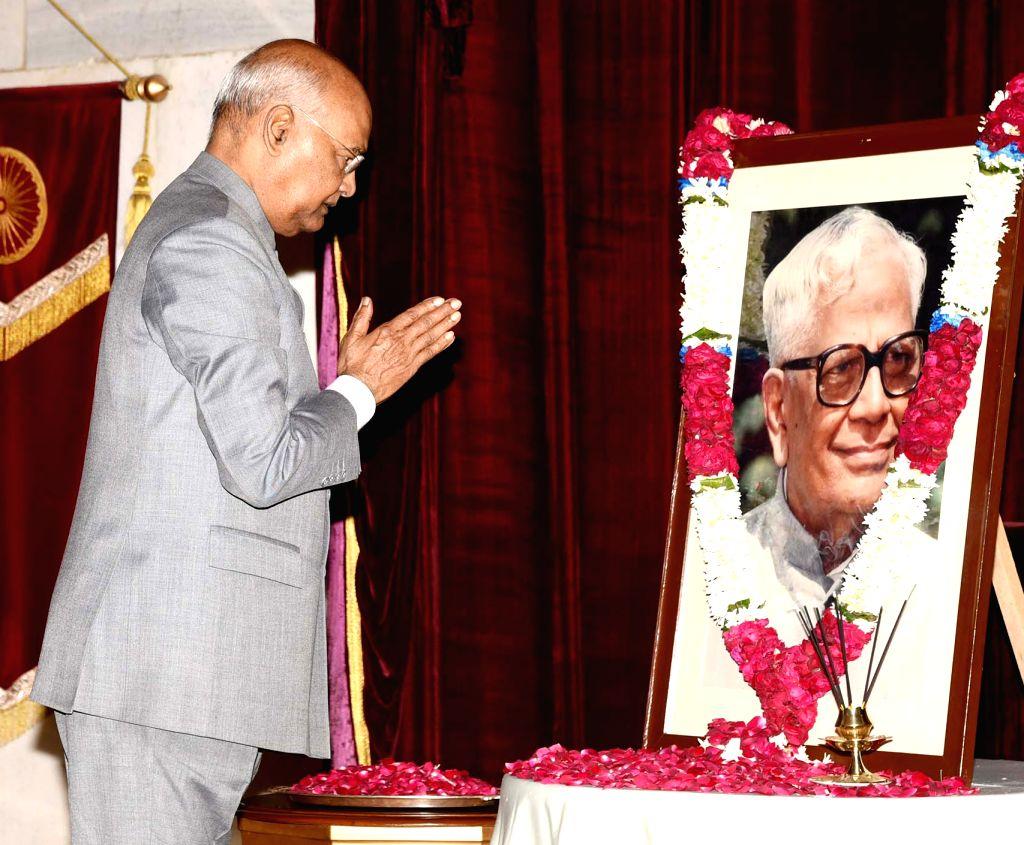 President Ram Nath Kovind pays homage at the portrait of the former President of India R. Venkataraman, on his birth anniversary at Rashtrapati Bhavan, in New Delhi on Dec 4, 2019. - Nath Kovind