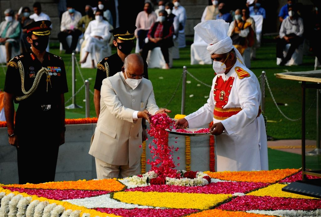 President Ram Nath Kovind pays homage to Mahatma Gandhi on the occasion of his 152nd birth anniversary, at Rajghat in New Delhi on Saturday, 02, 2021. - Nath Kovind