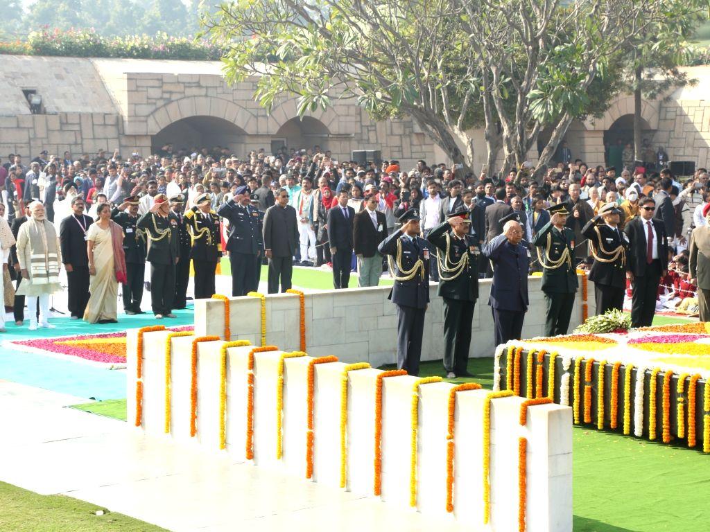 President Ram Nath Kovind pays tribute on death anniversary of Mahatma Gandhi at the samadhi of Mahatma Gandhi in Rajghat, New Delhi on Jan. 30, 2018. - Nath Kovind