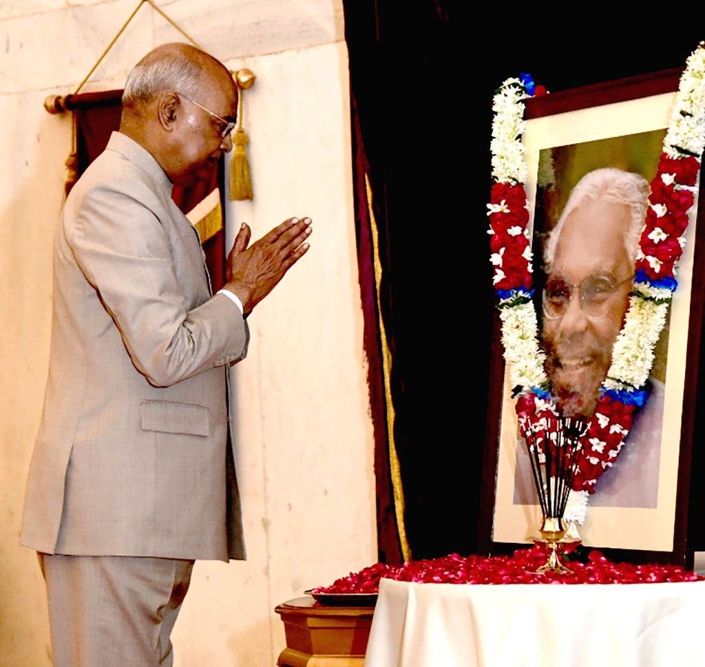 President Ram Nath Kovind pays tributes at the portrait of the former President of India KR Narayanan, on the occasion of his birth anniversary at Rashtrapati Bhavan in New Delhi on Oct ... - Nath Kovind