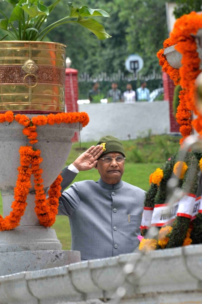 President Ram Nath Kovind pays tributes to the Kargil War martyrs at the Martyrs' Memorial inside the headquarters of Army's 15 Chinar Corps in Srinagar on July 26, 2019. - Nath Kovind