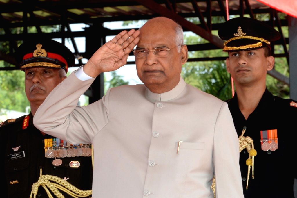 President Ram Nath Kovind presents colors to the Army Aviation Corps in a ceremonial parade at Army Aviation Base in Nasik on Oct 10, 2019. - Nath Kovind
