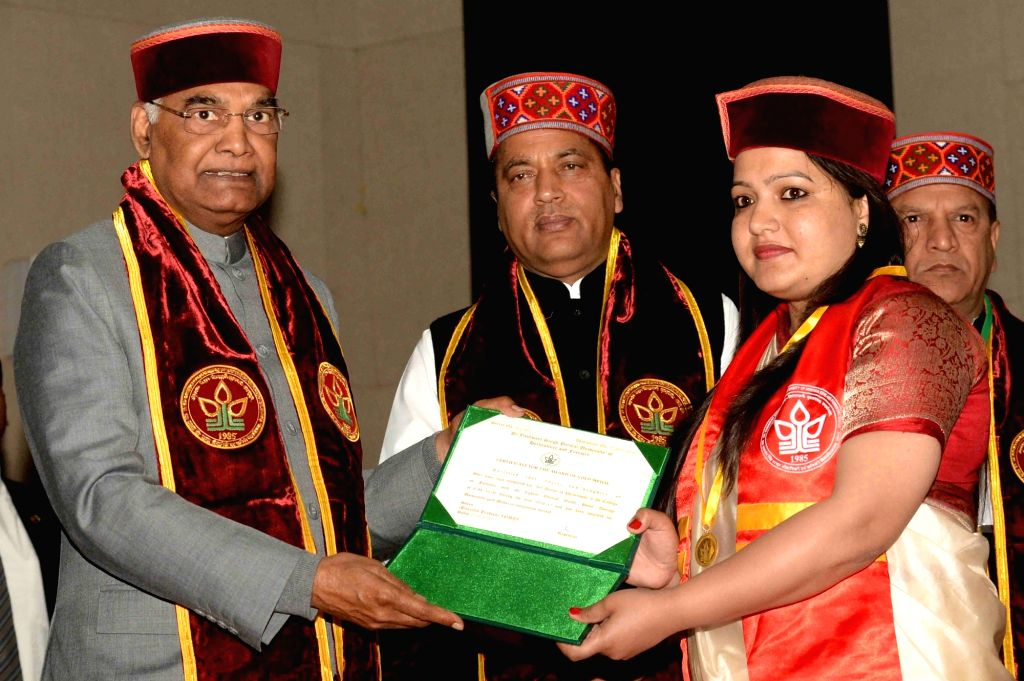 President Ram Nath Kovind presents degree to a student during the 9th convocation of Dr YS Parmar University of Horticulture and Forestry in Solan, Himachal Pradesh on May 21, 2018. - Nath Kovind