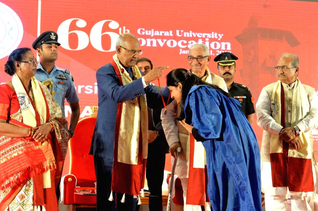 President Ram Nath Kovind presents medal to a student at the 66th Convocation of Gujarat University in Ahmedabad on Jan 21, 2018. - Nath Kovind