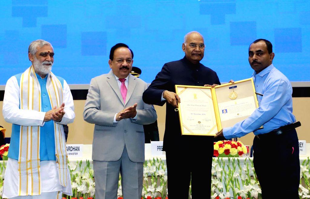 President Ram Nath Kovind presents the National Florence Nightingale Awards on the occasion of the International Nurses Day at Rashtrapati Bhavan, in New Delhi on Dec 5, 2019. Also seen ... - Nath Kovind