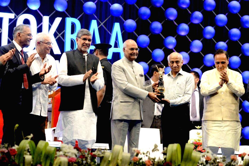 President Ram Nath Kovind presents the 'Santokbaa Humanitarian Award' to Indian Space Research Organisation (ISRO) Chairman A.S. Kiran Kumar, during the award presentation ceremony, in Surat ... - Vijay Rupani, Nath Kovind, S. Kiran Kumar and Prakash Kohli