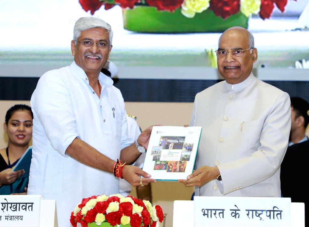 "President Ram Nath Kovind receives the Swachh Bharat Mission???s Book on Behaviour Change Communication from the Union Jal Shakti Minister Gajendra Singh Shekhawat at the ""Swachhata ... - Gajendra Singh Shekhawat and Nath Kovind"