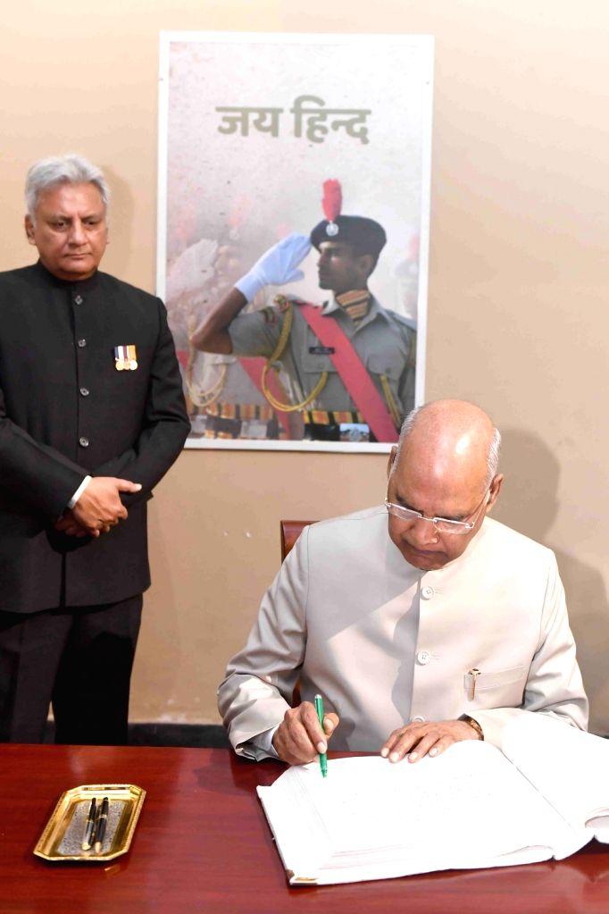 President Ram Nath Kovind signs the visitor's book of National Police Memorial, in New Delhi on April 9, 2019. - Nath Kovind