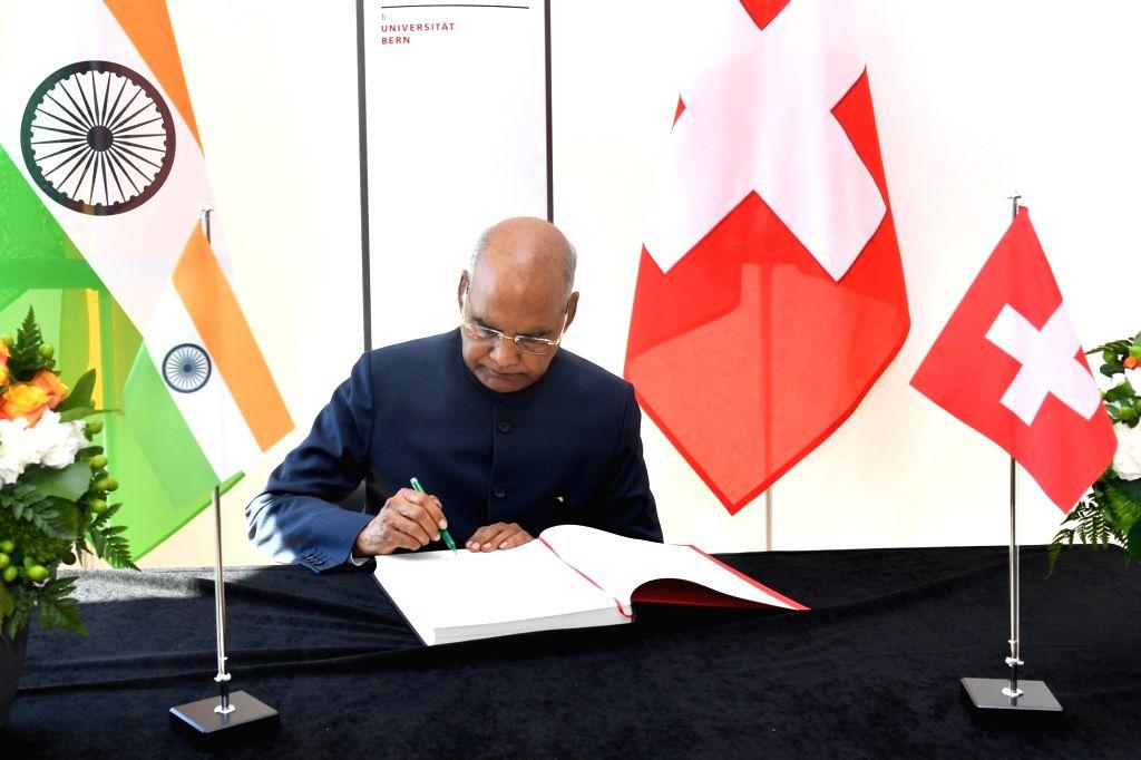President Ram Nath Kovind signs the Visitors' Book of University of Bern in Switzerland on Sep 13, 2019. - Nath Kovind